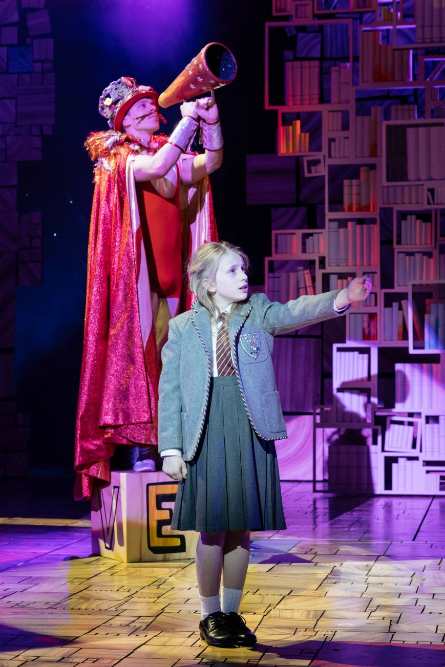 16-RSC Matilda The Musical UK & Ireland Tour. Steffan Lloyd-Evans (The Escapologist) and Poppy Jones (Matilda). Photo Manuel Har